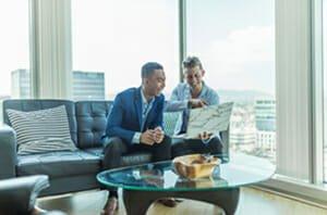 Two adults choosing Globe life insurance